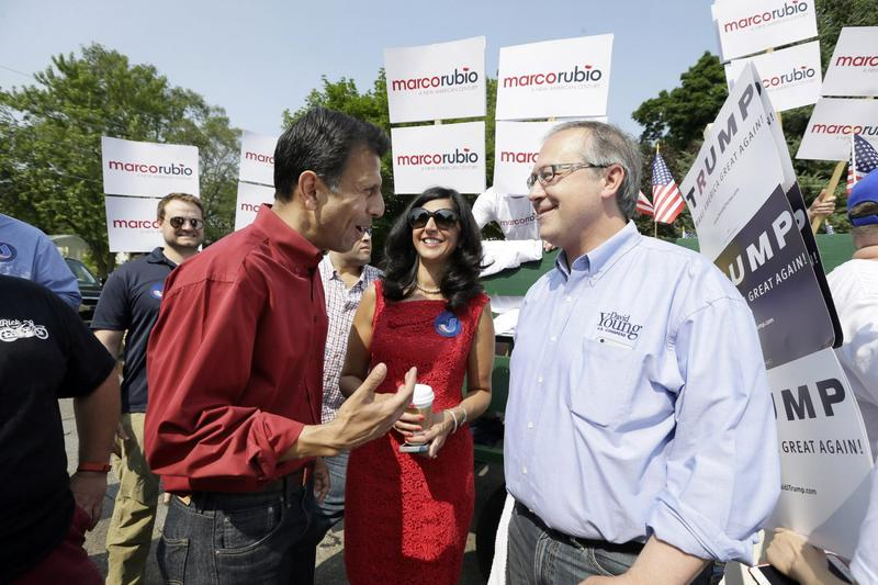 Republican presidential candidate Louisiana Gov. Bobby Jindal talks with Rep. David Young, R-Iowa, right, before walking in a Fourth of July parade in Urbandale, Iowa in 2015. (Charlie Neibergall/AP)