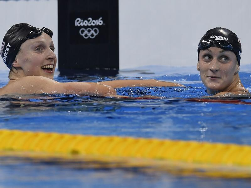 Katie Ledecky set a new world record Friday in the women's 800-meter freestyle. In the pool, she celebrated with Team USA teammate Leah Smith.
