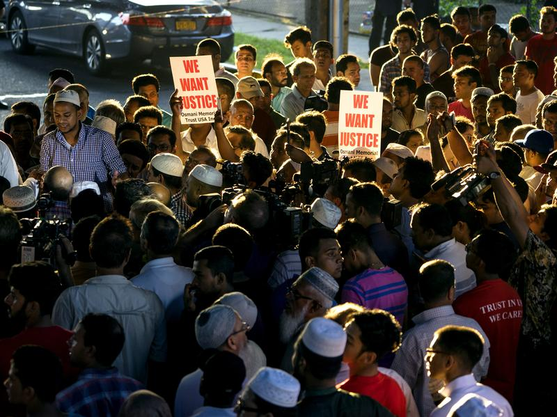 People gather for a demonstration Saturday near a crime scene after an imam and his friend were fatally shot while walking home from a mosque in the Ozone Park section of Queens, New York.