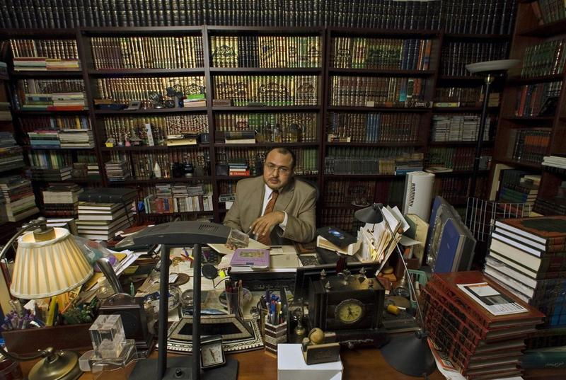 Islamic jurist professor Khaled Abou El Fadl, one of the world's preeminent Islamic scholars, holds a copy of the Qur'an in 2005 at his library in Los Angeles. (Damian Dovarganes/AP)