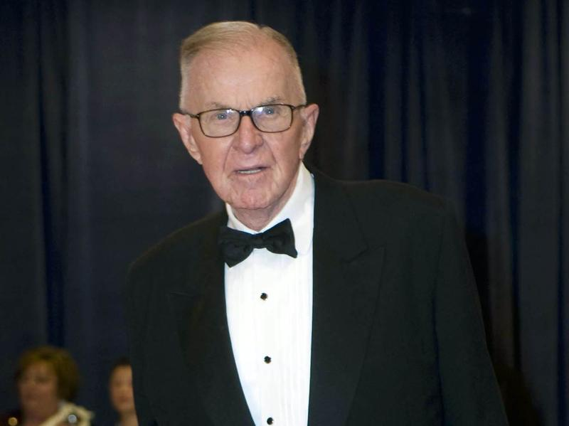 John McLaughlin arrives at the 2012 White House Correspondents' Association Dinner in Washington, D.C. McLaughlin, the conservative host of <em>The McLaughlin Group</em> television show that pioneered hollering-heads discussions of Washington politics, died Tuesday at the age of 89.