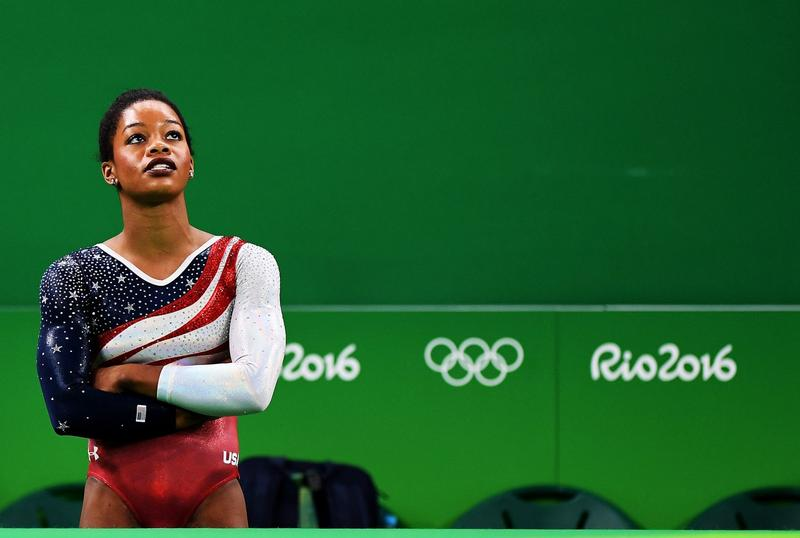 Gabby Douglas of the United States looks on the monitor to display the score at the Rio Olympics on Aug. 9, 2016 in Rio de Janeiro, Brazil. (Laurence Griffiths/Getty Images)