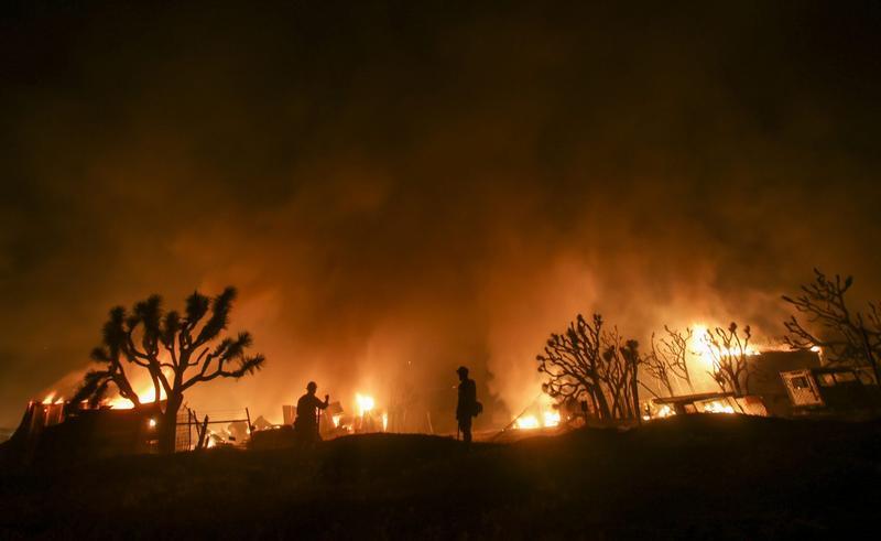 Firefighters watch the Blue Cut wildfire near Cajon Pass, north of San Bernardino, California on Aug. 16, 2016. (Ringo Chiu/AFP/Getty Images)