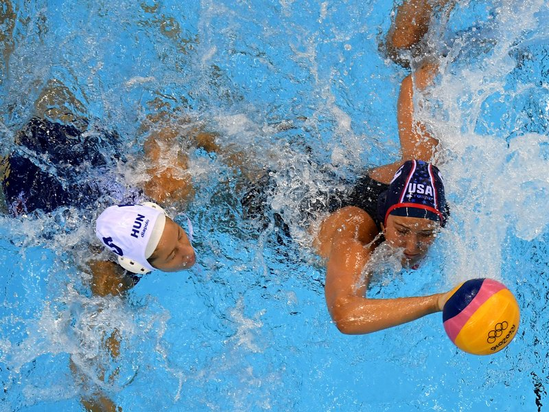 Gabriella Szucs of Hungary battles with Courtney Mathewson of the U.S. during the women's water polo semifinal match on Wednesday. The U.S. won, 14-10, to advance to the gold medal game against Italy on Friday.