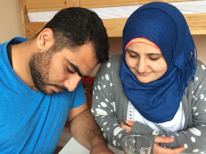 """Firas Awad (left) and wife Tamam Aldrawsha, from Syria, spend hours studying German every day. Awad wants to complete the pharmacy studies he abandoned because of the Syrian war, and Aldrawsha wants to become a nurse. """"I want to be useful,"""" she says. """"Useful for my family and useful for this country."""""""