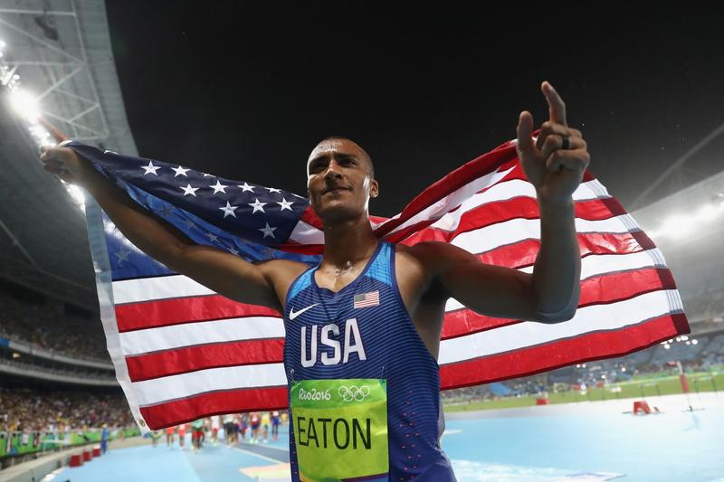 Ashton Eaton of the United States celebrates winning gold overall after the Men's Decathlon 1500m on Day 13 of the Rio 2016 Olympic Games at the Olympic Stadium on Aug. 18, 2016 in Rio de Janeiro, Brazil. (Alexander Hassenstein/Getty Images)