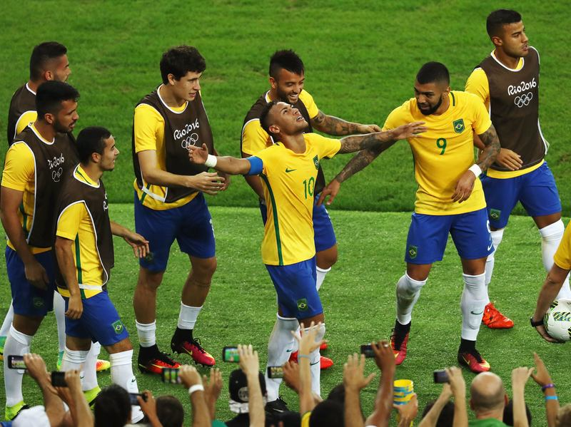 Neymar of Brazil is surrounded by teammates as he celebrates scoring the first goal in the men's soccer final against Germany at Rio's Maracana Stadium. Neymar made the crucial penalty kick that won the game for Brazil.