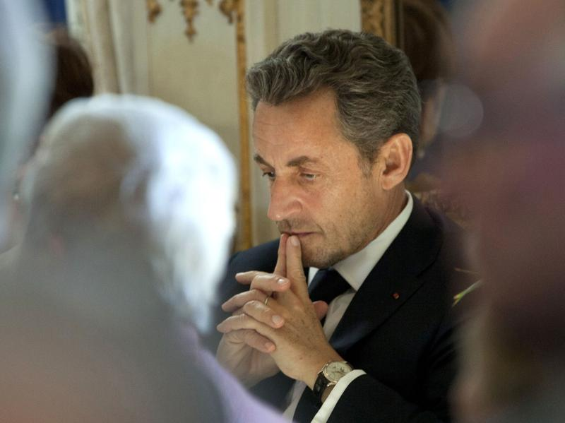 Former French President Nicolas Sarkozy says he will try to return to the office. He's pushing hard-line policies on immigration and security.