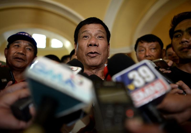 Davao City Mayor and Presidential Candidate Rodrigo Duterte speaks to reporters in Lingayen, Pangasinan, north of Manila on March 2, 2016. (Noel Celis/AFP/Getty Images)