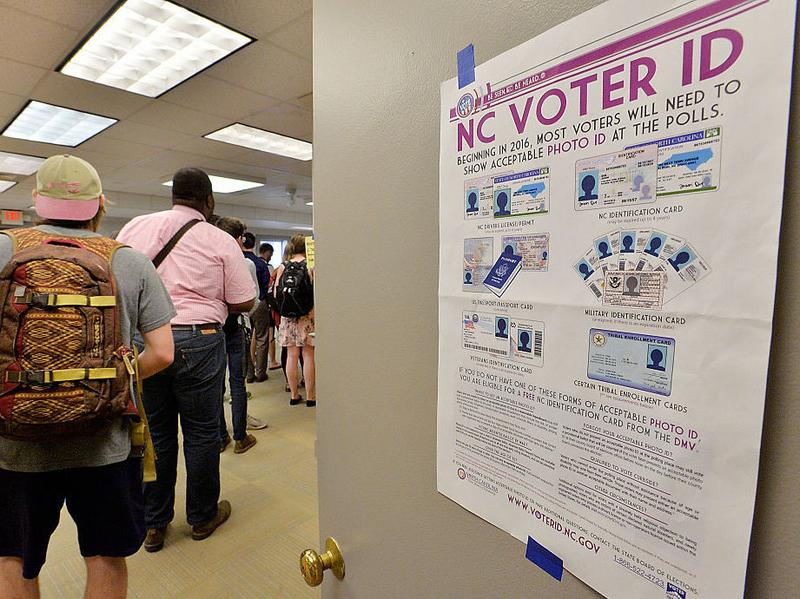North Carolina State University students wait in line to vote in the primaries in Raleigh. North Carolina is one of several states with voting laws in front of the courts.