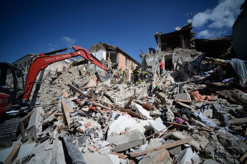 Rescuers and firemen inspect the rubble of buildings in Amatrice, Italy on Aug. 24, 2016. (Filippo Monteforte/AFP/Getty Images)