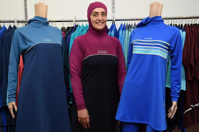 Fitness instructor Fatma Taha wears a burkini swimsuit as she poses for pictures at a shop in western Sydney, Australia on Aug. 19, 2016. (Saeed Khan/AFP/Getty Images)