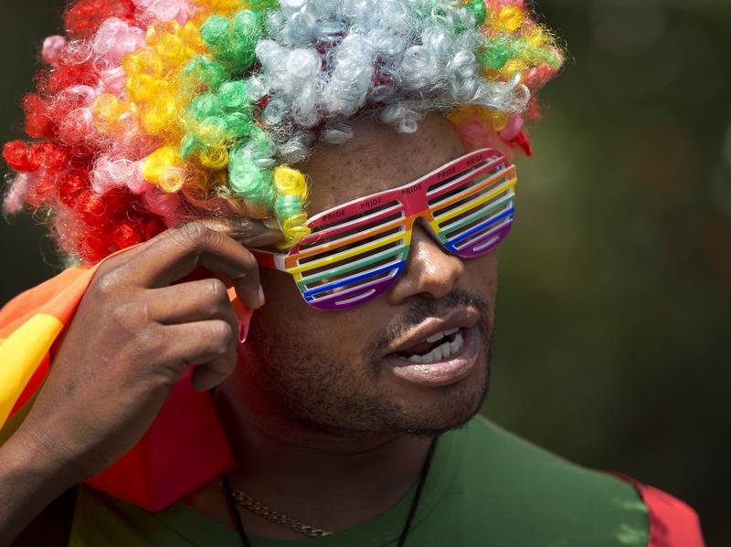 A protester in a rainbow-colored wig and glasses joins a 2014 rally in Kenya to protest Uganda's increasingly tough stance on homosexuality.