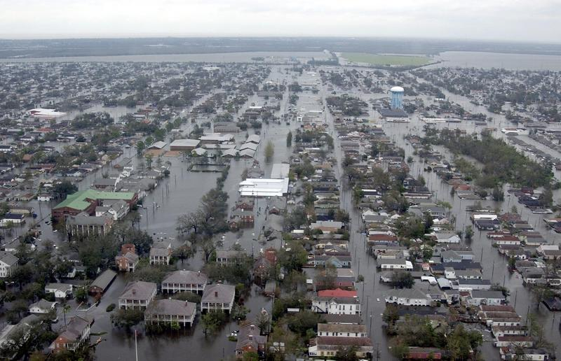 In this handout photo, flooded neighborhoods can be seen as the Coast Guard conducts initial Hurricane Katrina damage assessment overflights Aug. 29, 2005 in New Orleans, Louisiana. (Kyle Niemi/US Coast Guard via Getty Images)