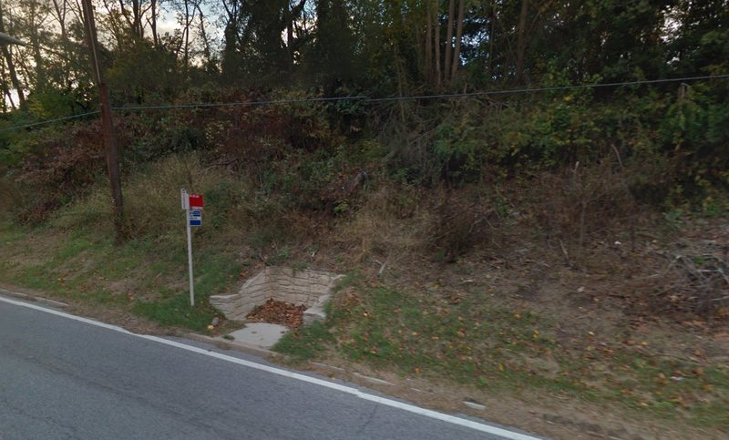 """A bus stop at the intersection of Route 29 and Crestmoor Drive in Silver Spring, Maryland. The stop was voted the country's """"sorriest bus stop,"""" according to Streetsblog USA. (Google Maps)"""