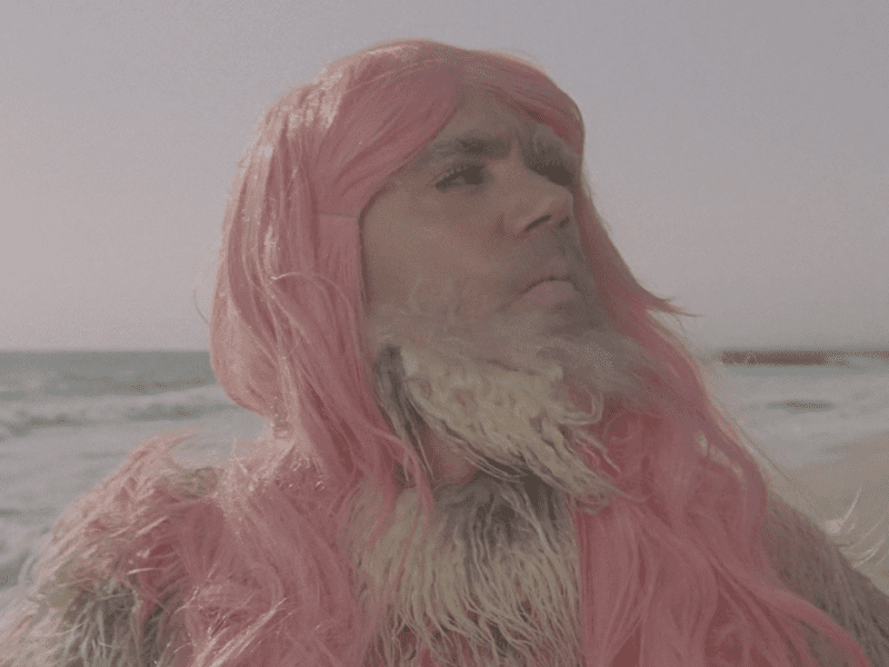 """A pink yeti struts the beach in a scene from Deap Vally's video for the song """"Gonnawanna."""""""