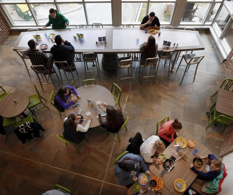 Students at the University of New Hampshire have lunch at a campus dining hall in April 2016 in Durham, N.H. (Jim Cole/AP)