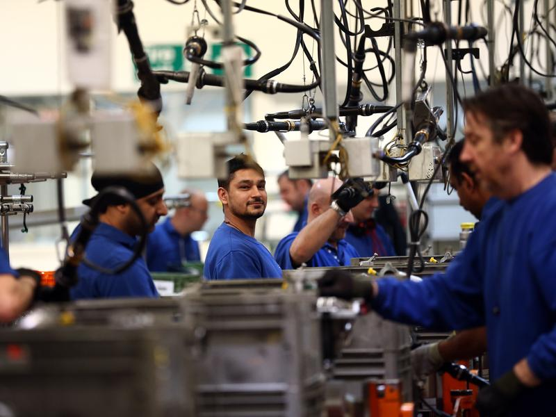 Employees work on an engine production line at a Ford factory in Dagenham, England. Many American firms based in the U.K. are concerned Brexit will adversely impact their businesses.