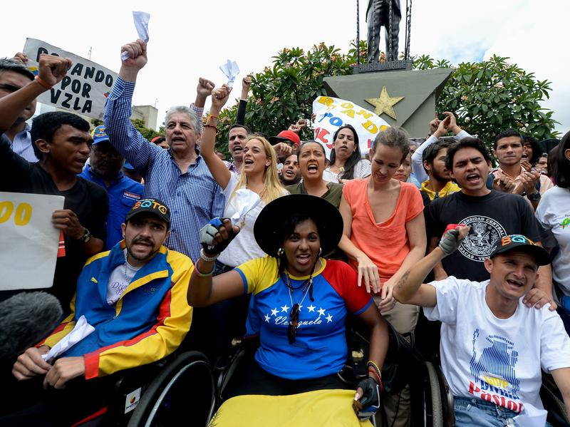 Lilian Tintori, second row center, in white top, the wife of jailed opposition leader Leopoldo Lopez, takes part in a demonstration in Caracas on Aug. 31. Venezuelan President Nicolas Maduro vowed Tuesday to jail opposition leaders if they incite violence during upcoming protests seeking a referendum on removing him from power.