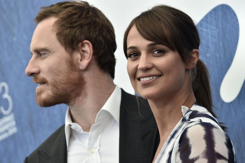 """British actor Michael Fassbender and Swedish actress Alicia Vikander pose during a photocall of the movie """"The Light Between Oceans"""" at the 73rd Venice Film Festival on Aug. 31, 2016 at Venice Lido. (Tiziana Fabi/AFP/Getty Images)"""