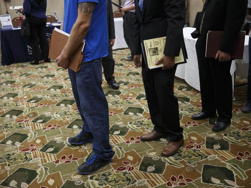 Job seekers wait to speak with representatives during a Choice Career Fair this summer in Los Angeles.