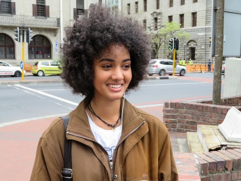 "Zia Simpson, a student and sales assistant in Cape Town, says even her father tells her to tame her Afro. ""That generation fought against apartheid, but they still carry around the mentality that green eyes look better on a person, that straight hair looks better on a person."""
