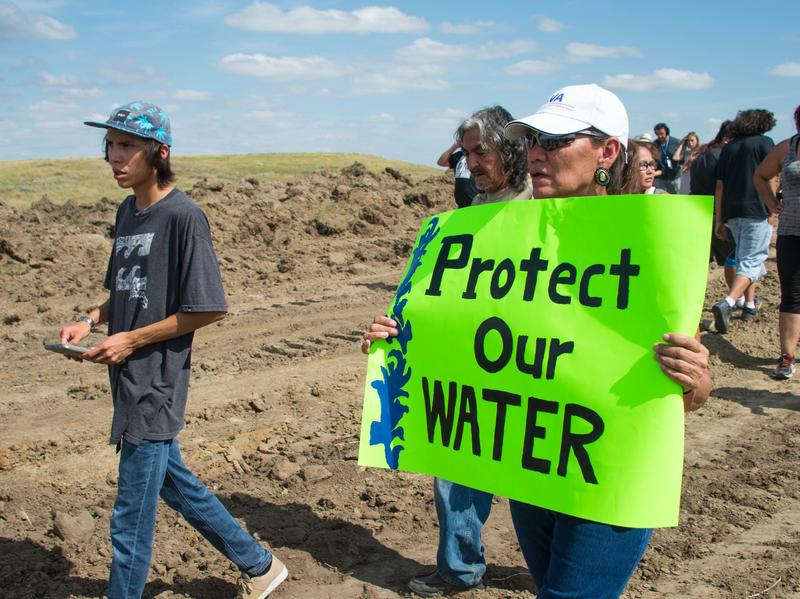 A protestor is treated after being pepper sprayed by private security contractors on land being graded for the Dakota Access Pipeline near Cannon Ball, N.D., Sept. 3, 2016.