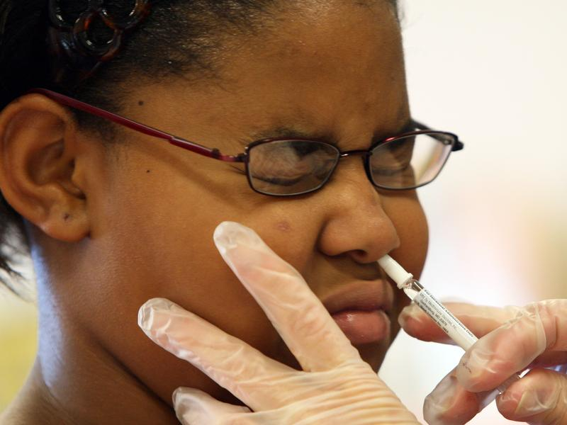 Fourth-grader Jasmine Johnson got a FluMist spray at her Annapolis, Md., elementary school in 2007. This year, the nasal spray vaccine isn't recommended.