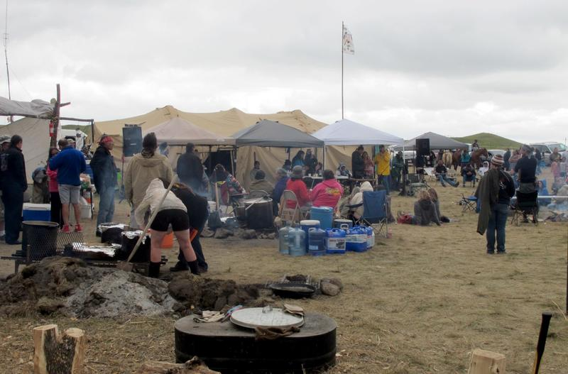 People protesting the construction on a four-state oil pipeline at a site in southern North Dakota gather at campground near the Standing Rock Sioux reservation on Thursday, Aug. 25, 2016. (James MacPherson/AP)