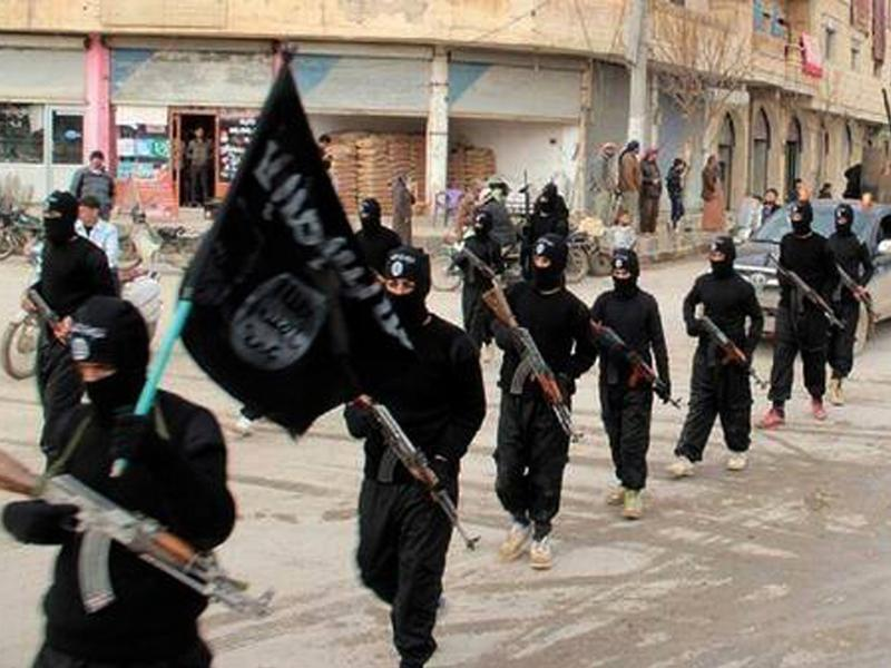Islamic State fighters march in Raqqa, Syria, in an undated file photo released in 2014. The U.S. has been bombing ISIS in Syria and Iraq for the past two years. A U.S. Army captain has sued President Obama, arguing the U.S. war against the extremist group is not legal because the U.S. Congress has not authorized it.