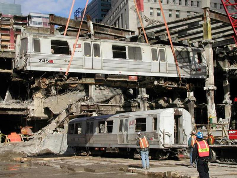 During recovery from the World Trade Center wreckage, Car 745 is swung over Car 143 by crane. (Peter Rinaldi/Shoreline Trolley Museum)