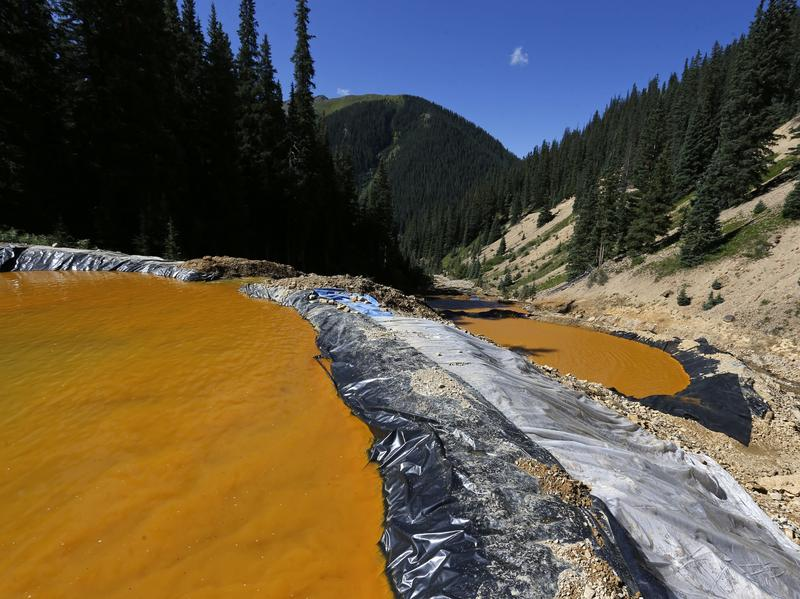 Water flows through a series of sediment retention ponds in August 2015 that were built to contain heavy metal and chemical contaminants from the Gold King Mine wastewater accident in Colorado. That site, and 47 others in southwest Colorado, were declared Superfund sites on Wednesday.