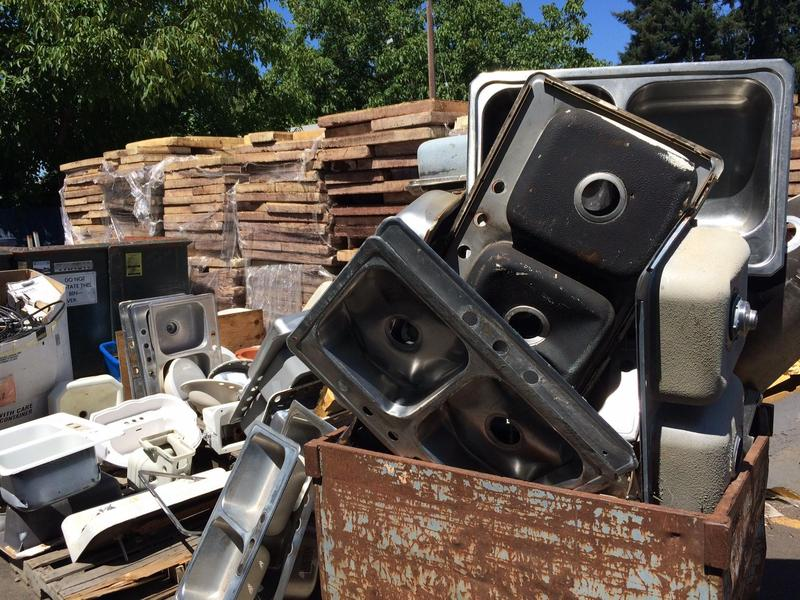 A stack of steel sinks donated to BRING Recycling. (Brian Bull/KLCC)