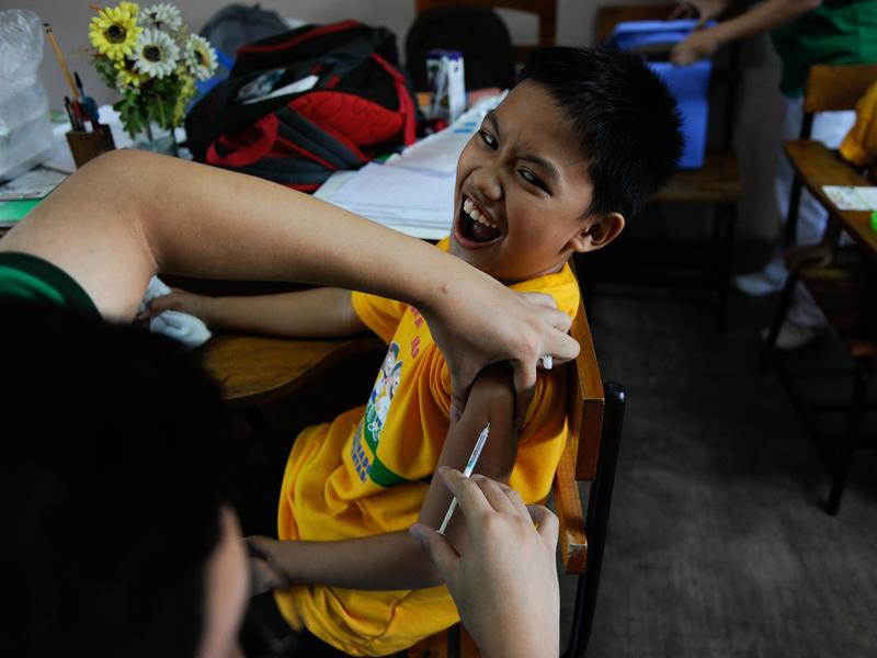 A boy in the Philippines is vaccinated for dengue fever on April 4. In a new survey, only 2 percent of people polled in the Philippines thought vaccines were unsafe.