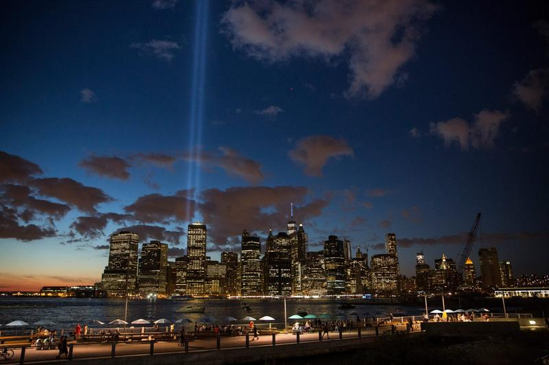 The September 11 Tribute in Light rises from the New York City skyline as seen from the Brooklyn Heights neighborhood of the Brooklyn Borough of New York City on Sept. 11, 2015. (Andrew Burton/Getty Images)