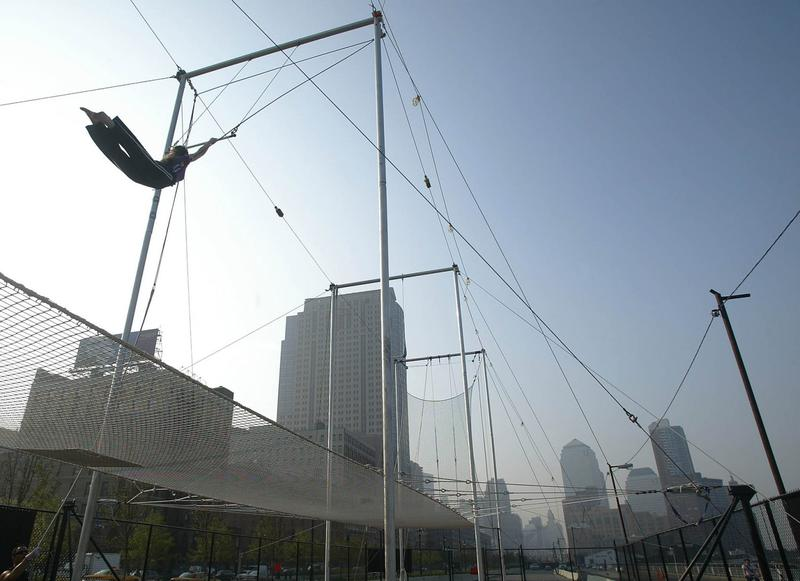 A student of the Trapeze School of New York sails through the air on Oct. 3, 2002, in downtown Manhattan in New York City. (Doug Kanter/AFP/Getty Images)