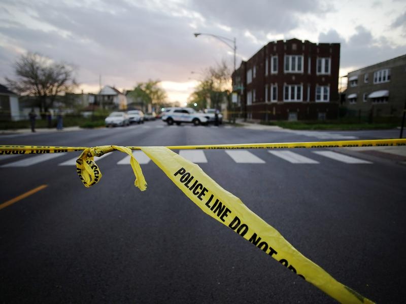 Police crime tape marks the scene where a 16-year-old boy was shot and killed and an 18-year-old man was wounded in April in Chicago. The grim milestone of 500 homicides already passed this year in Chicago.