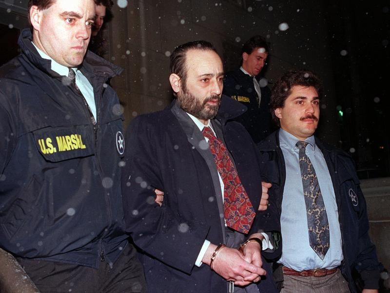 """In 1993, Eddie Antar, founder of the Crazy Eddie electronics store chain, is led in handcuffs after being extradited from Israel. Thousands of the chain's commercials starred pitchman Jerry Carroll, who touted prices as """"insane."""""""