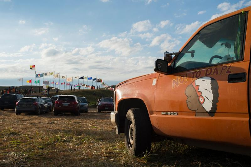 Flags of Native American tribes from across the U.S. and Canada line the entrance to a protest encampment near Cannon Ball, North Dakota, where members of the Standing Rock Sioux Tribe and their supporters have gather to voice their opposition to the Dakota Access Pipeline (DAPL), Sept. 3, 2016. (Robyn Beck/AFP/Getty Images)