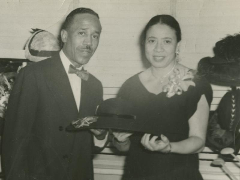 Mae Reeves and her husband Joel pose with her hats at Mae's Millinery in Philadelphia, circa 1953.