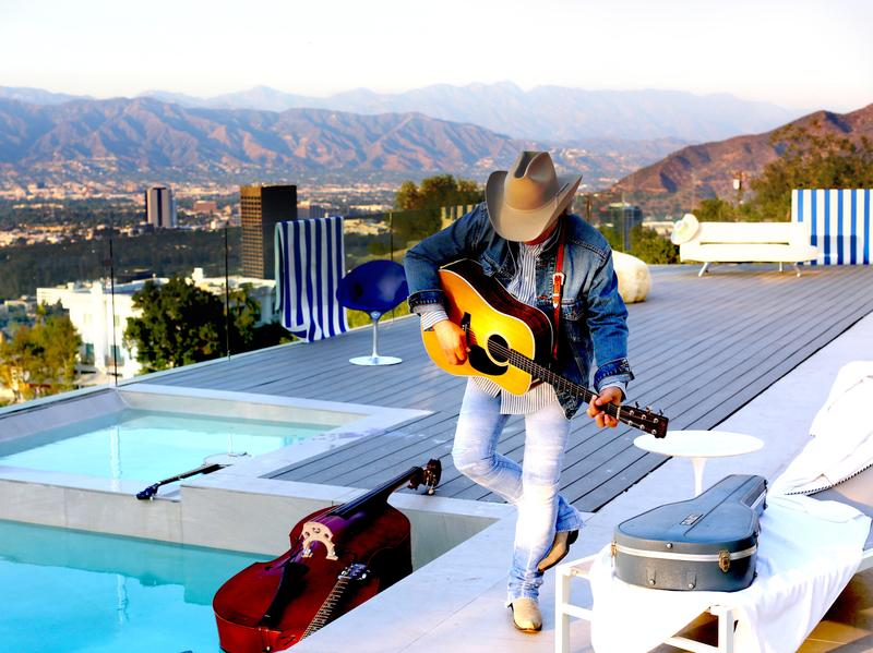 Dwight Yoakam's new album, <em>Swimmin' Pools, Movie Stars...</em>, comes out Sept. 23.