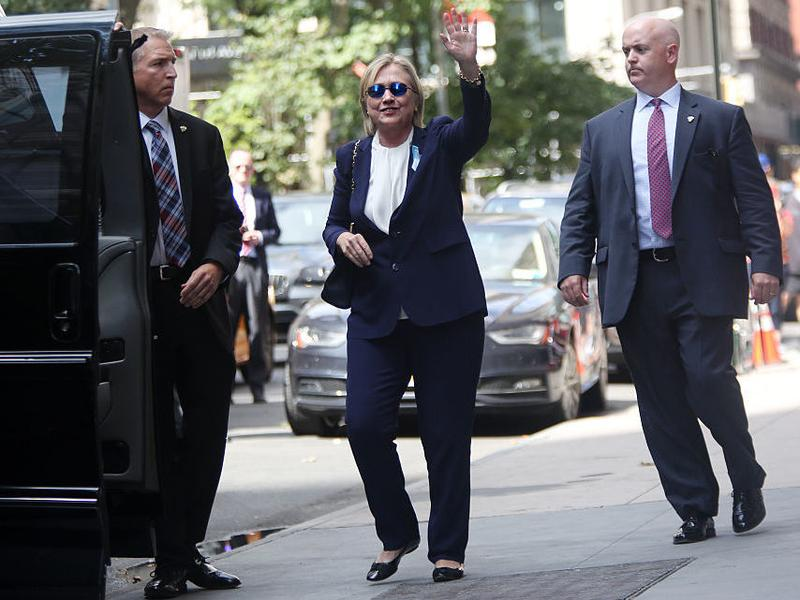 Hillary Clinton exits her daughter Chelsea Clinton's apartment on Sunday after she became sick at a Sept. 11 memorial service. Diagnosed with pneumonia, she had taken several days off the campaign trail to recover.