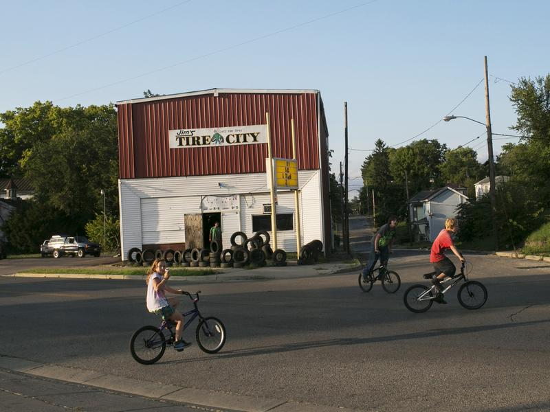 """Kids bike on Selma Road in Springfield, Ohio. """"Springfield is a rather typical small city that has grown poorer over the years,"""" former mayor Roger Baker says."""