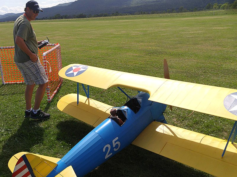 Mike Pecue prepares to send his biplane into the sky over Westport, N.Y.