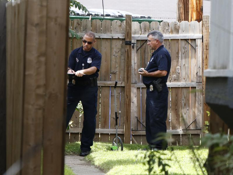 Members of the Columbus Police Crime Scene Search Unit investigate the area around the fatal police shooting of Tyre King, 13, Wednesday night.