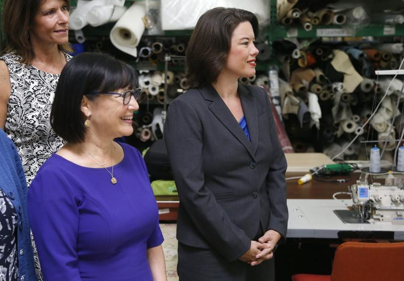 Minnesota Democratic congressional candidates Sen. Terri Bonoff, left, and Angie Craig, right, tour the Airtex Design Group prior to a round table discussion, Wednesday, Aug. 24, 2016 at the textile manufacturing business in Minneapolis. (Jim Mone/AP)