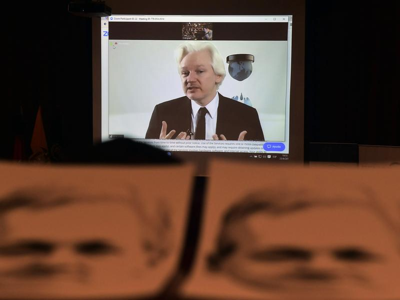 WikiLeaks founder Julian Assange appears via videoconference at an auditorium in Quito, Ecuador, on June 23.