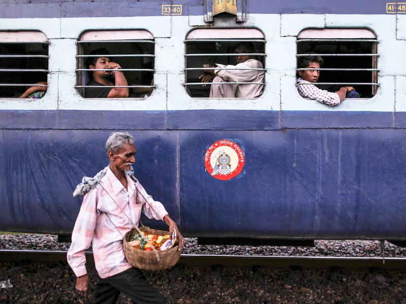 Train journeys in India were once defined by food, brought by passengers from their homes and purchased from vendors like this one. Passengers shared food with each other, exchanging stories and family  histories, and sometimes striking new friendships that continued beyond the journey. But with growing availability of packaged food on trains, that culture is slowly dying.