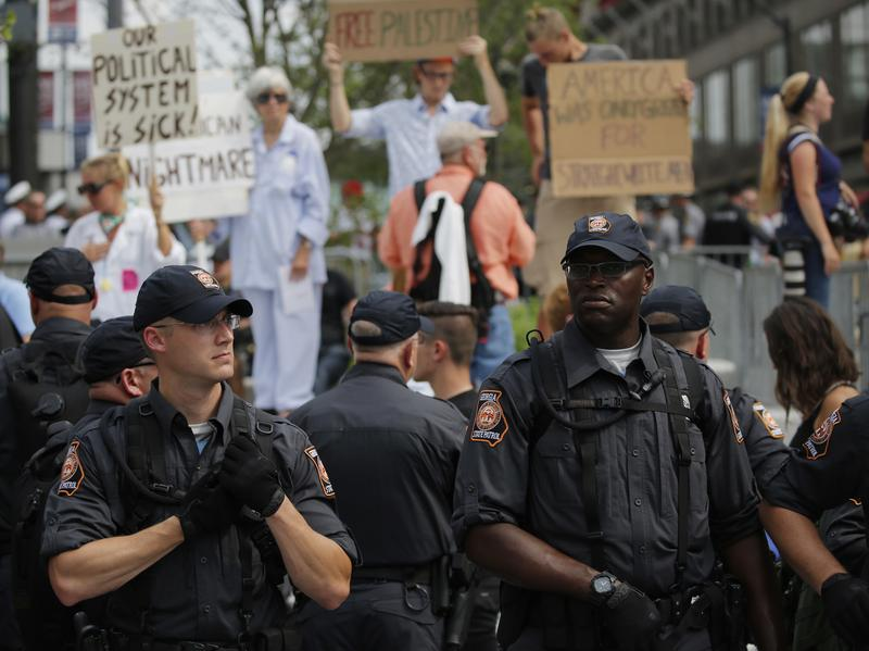 Police and protesters at Cleveland Public Square on the final day of the Republican National Convention in July in Cleveland.