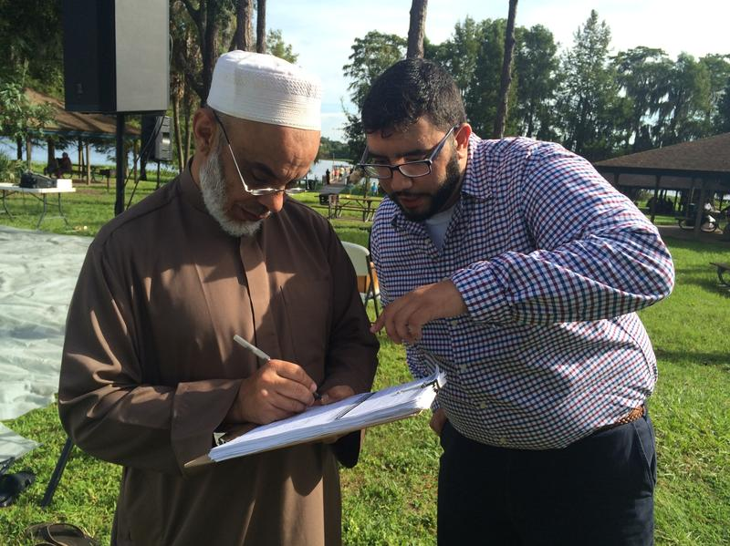 Mohamad Shatara registers a Muslim man to vote.